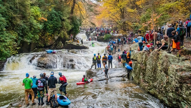 Hundreds of spectators came out to cheer on expert paddlers competing in the Green River Narrows Race in 2017 in Polk County.