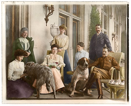 This colorized version of a photograph from the Vanderbilt archives depicts afternoon tea on the Loggia of Biltmore House with the Vanderbilts in September 1900. Pictured from left are Edith Vanderbilt, Madame Rambaud (Edith's former chaperone), Lila Vanderbilt Webb (George Vanderbilt's sister), Mary Webb (Lila's sister-in-law), Isabella Stewart Gardner, an unidentified man and George Vanderbilt.