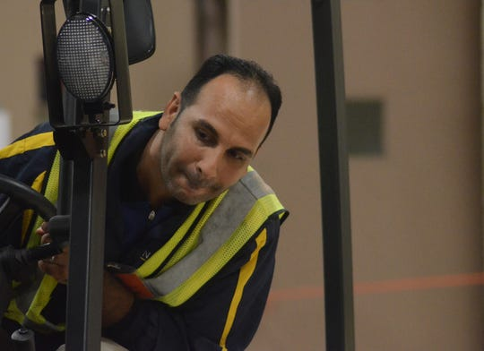 Husain Alawai of Bahrain watches as he completes a lifttruck maneuver at the Battle Creek Air National Guard Base for the Defense Logistics Agency's first Material Handling Equipment Rodeo.