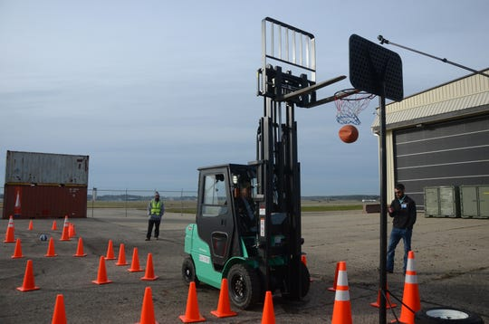 "Jeff Hallauer of Pearl Harbor, Hawaii drops a basketball through the hoop as part of the ""Slam Dunk"" exercise this week."