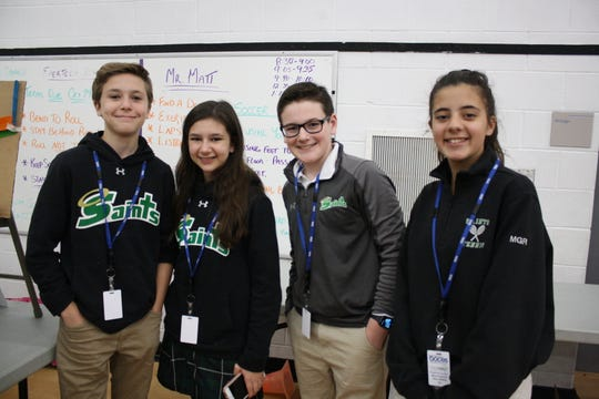 From left: Seton Catholic Central High School students Ashton McCann, 13, of Binghamton, Jillian Ferrarese, 13, of Oxford, Andrew Sarra, 12, of Binghamton, and Mary Redmore, 12 of Binghamton were one of the 90 teams of students at the fourth annual Engineering Day Thursday morning.