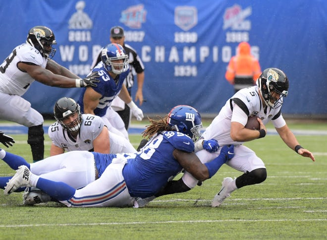 """Damon """"Snacks"""" Harrison, shown sacking Blake Bortles of Jacksonville, was traded this week from the New York Giants to the Detroit Lions."""