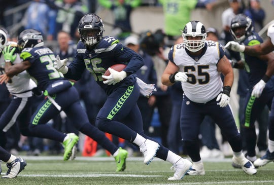 Seahawks defensive end Frank Clark returns an interception during an Oct. 7 loss to the Rams. He also forced a fumble in that game and made two tackles, one for loss, while playing a few days after falling ill from food poisoning.