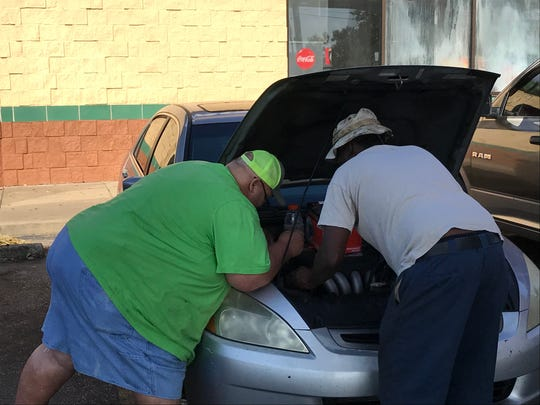 Pastor Charlie (left) and his friend, Mr. Brown, installed a new alternator pro bono for me in Chipley, Florida, after days of covering damage from Hurricane Michael.