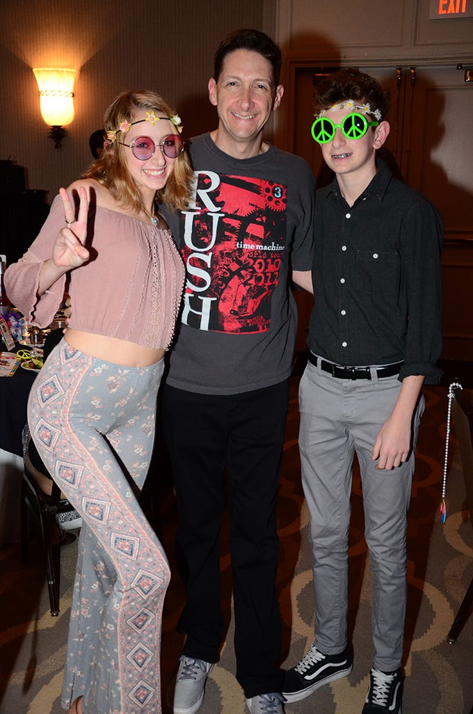 Posing Saturday evening were Macie, Loren, and Lucas Goldfarb. They attended the Family Partnership's 4th Annual Decades in Revue Lip Sync Battle benefit held at the Melbourne Hilton Rialto. (photo by Tony Dees/for Florida Today)