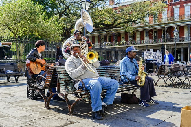 Musicians in New Orleans' Jackson Square treat passersby to Dixieland jazz.