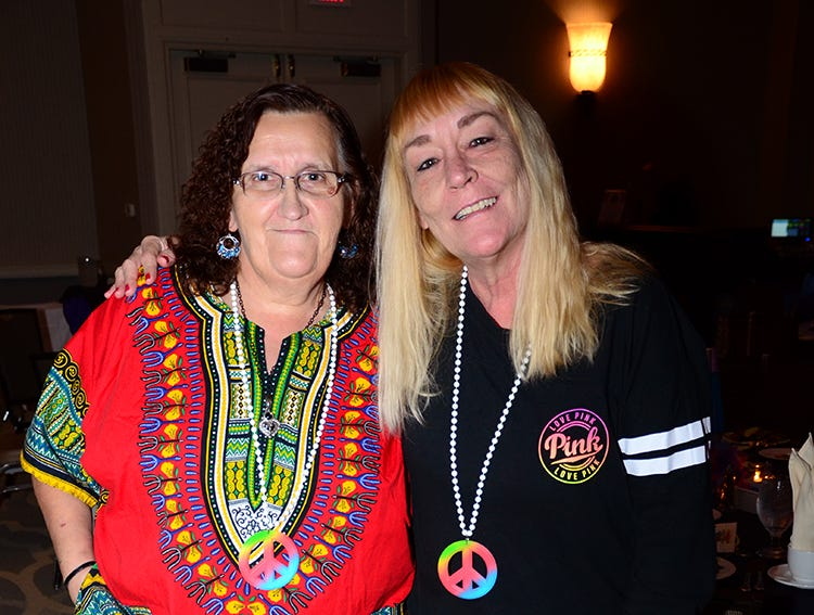 Kathy Bailey and Robin Wilson show their support Saturday evening for the Family Partnership's 4th Annual Decades in Revue Lip Sync Battle benefit held at the Hilton Rialto in Melbourne. (photo by Tony Dees/for Florida Today)