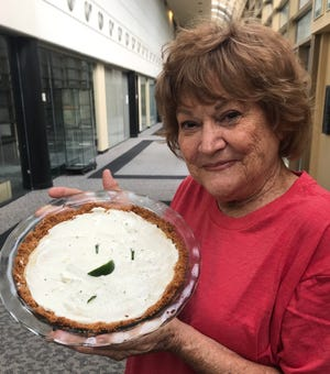 Beth Davis, shown with one of her homemade key lime pies, isn't afraid to go up against the pros at the Chew at the Zoo on Nov. 10. The Mississippi native has been cooking all her life.