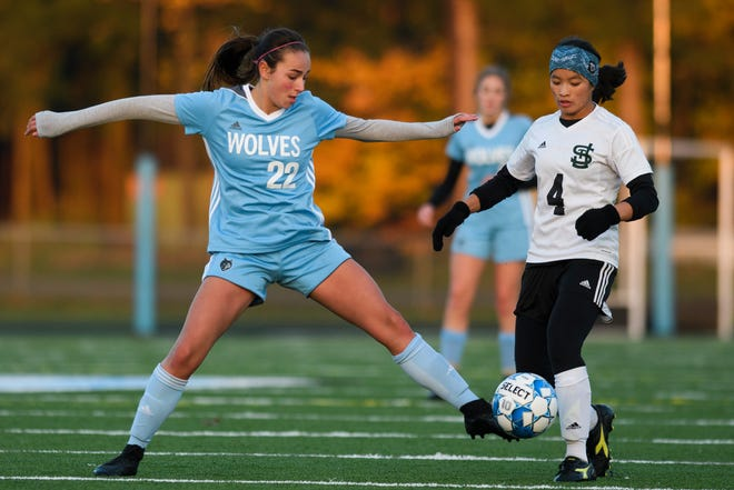 South Burlington's Julia Hasenecz (22) battles for the ball with St. Johnsbury's Jen Rotti (4) during the girls playoff game between the St. Johnsbury Hilltoppers and South Burlington Wolves at Munson Field on Wednesday afternoon October 24, 2018 in South Burlington.