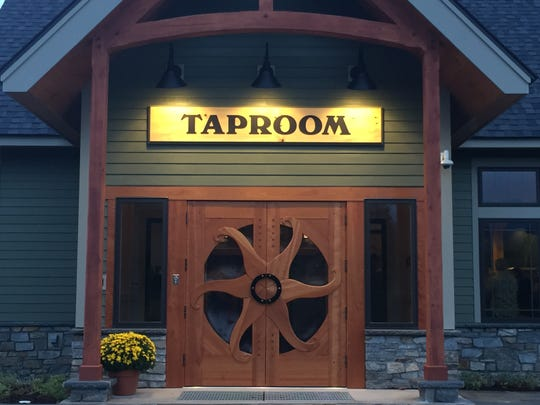 Renowned Vermont architect David E. Sellers designed the doors at Lawson's Finest Liquids' new taproom in Waitsfield.