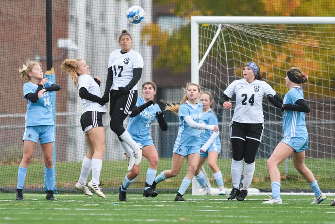 St. Johnsbury's Zekiah Lewis (17) leaps to head the ball during the girls playoff game between the St. Johnsbury Hilltoppers and South Burlington Wolves at Munson Field on Wednesday afternoon October 24, 2018 in South Burlington.