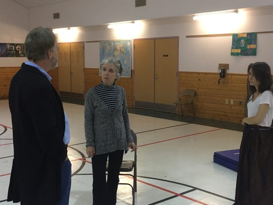 """Director Melissa Lourie (center) discusses a scene from """"The Turn of the Screw"""" with actors Bruce Campbell and Grace Experience during a rehearsal at Weybridge Elementary School on Oct. 15, 2018."""