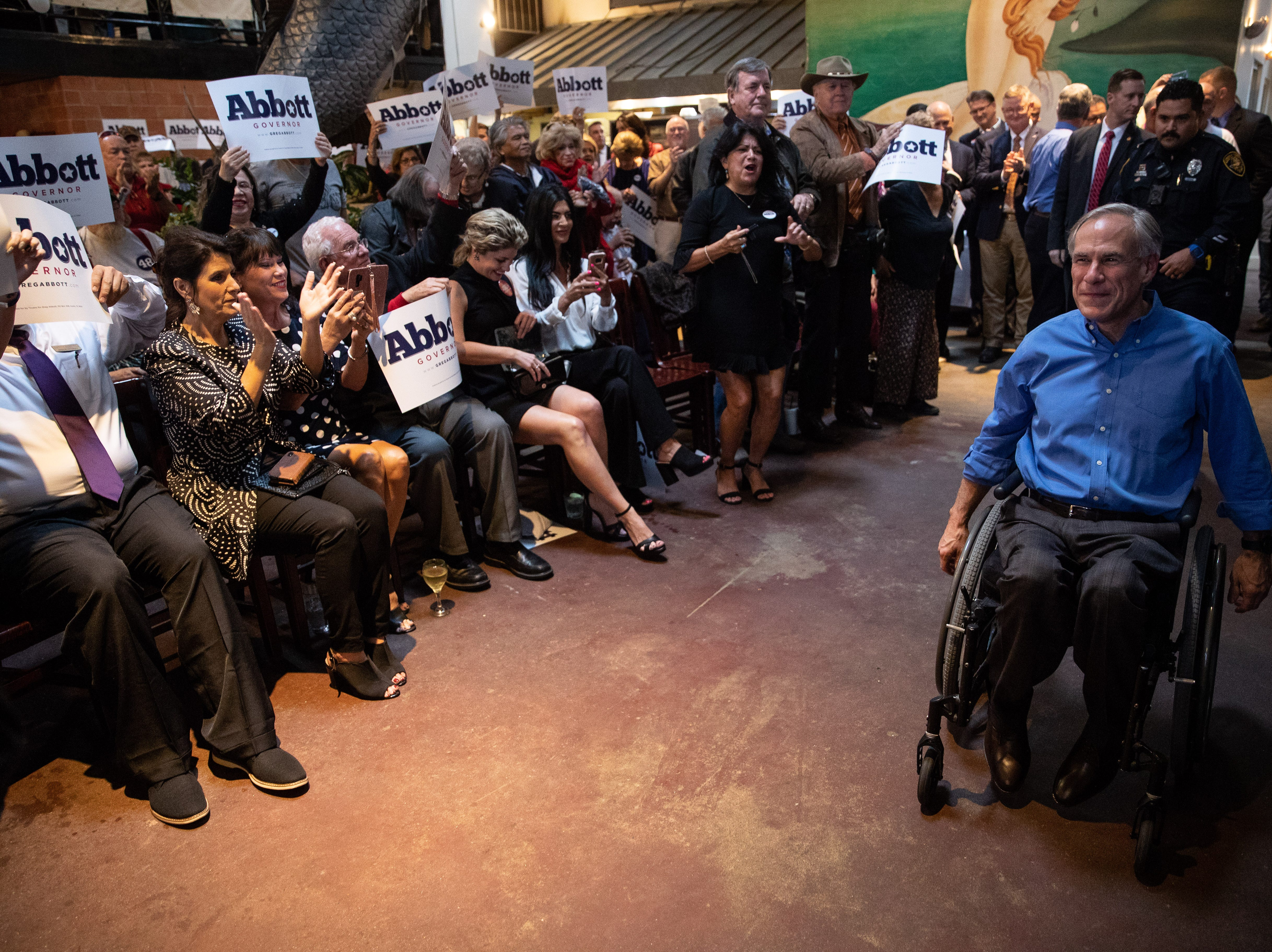 Texas Gov. Greg Abbott arrives at a Get Out the Vote stop in Corpus Christi at Water Street Oyster Bar on Thursday, Oct. 25, 2018.
