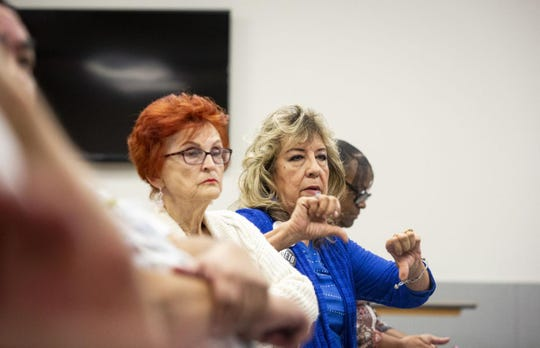 Marie Pena, of Gonzales, gives a thumbs down during Thursday's Dist. 27 congressional debate.