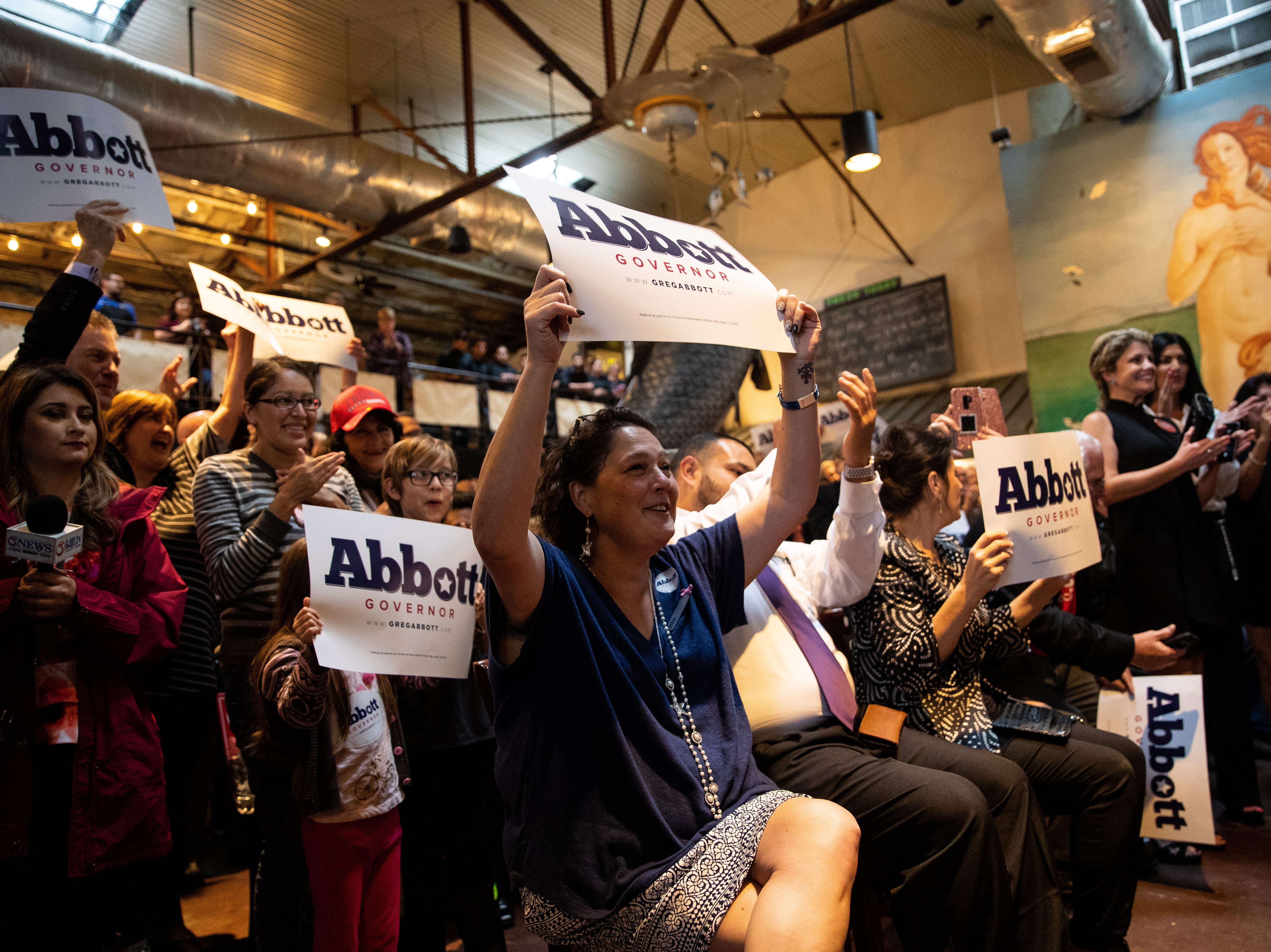 People cheer for Texas Gov. Greg Abbott as he speaks at a Get Out the Vote stop in Corpus Christi at Water Street Oyster Bar on Thursday, Oct. 25, 2018.