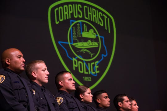 In this 2016 file photo, graduating police cadets stand on stage during the 75th police academies graduation ceremony at the Selena Auditorium.