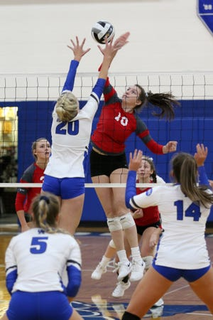 Sheridan's Rachel Cooke hits a spike against a Gallia Academy defender, as the Generals defeated Gallia Academy 3-2 in Wednesday's Division II district semifinal at Southeastern High School in Chillicothe. They advanced to Saturday's district final against Unioto at 4 p.m. Saturday.