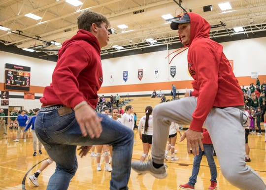 Zane Trace's Chad Ison, left, and Elliott Lynn celebrate after Zane Trace defeated North Adams Wednesday night in a Division III district semifinals match.