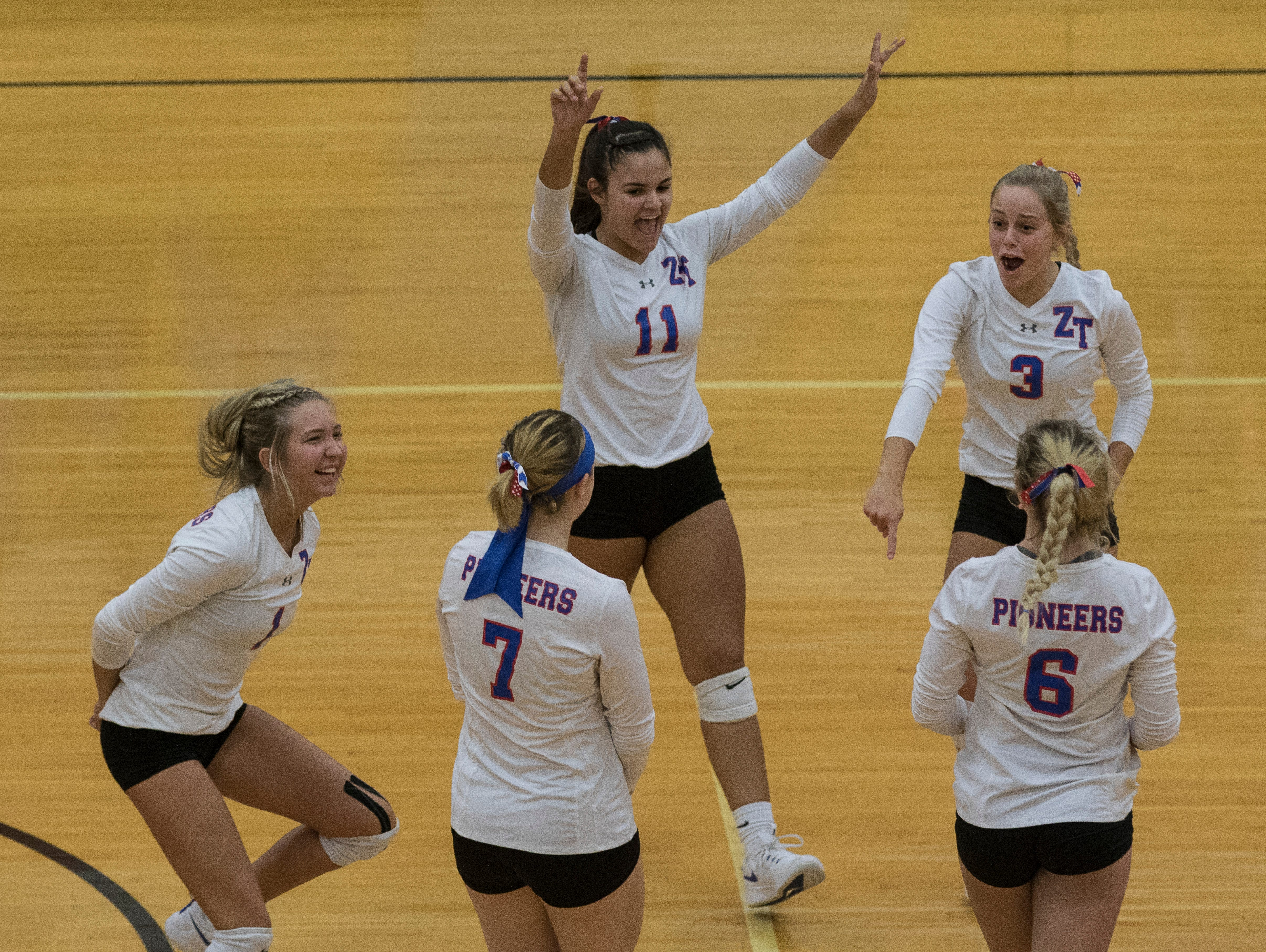 The Zane Trace girls volleyball team celebrate after winning their first set against North Adams Wednesday night 3-0 at Waverly High School.