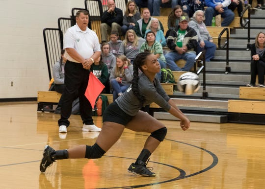 Huntington's Mica Cox returns a volley served by Southeastern Wednesday night during a Division III district semifinals match. Huntington fell to Southeastern 3-2, advancing Southeastern to district finals against Zane Trace Saturday.