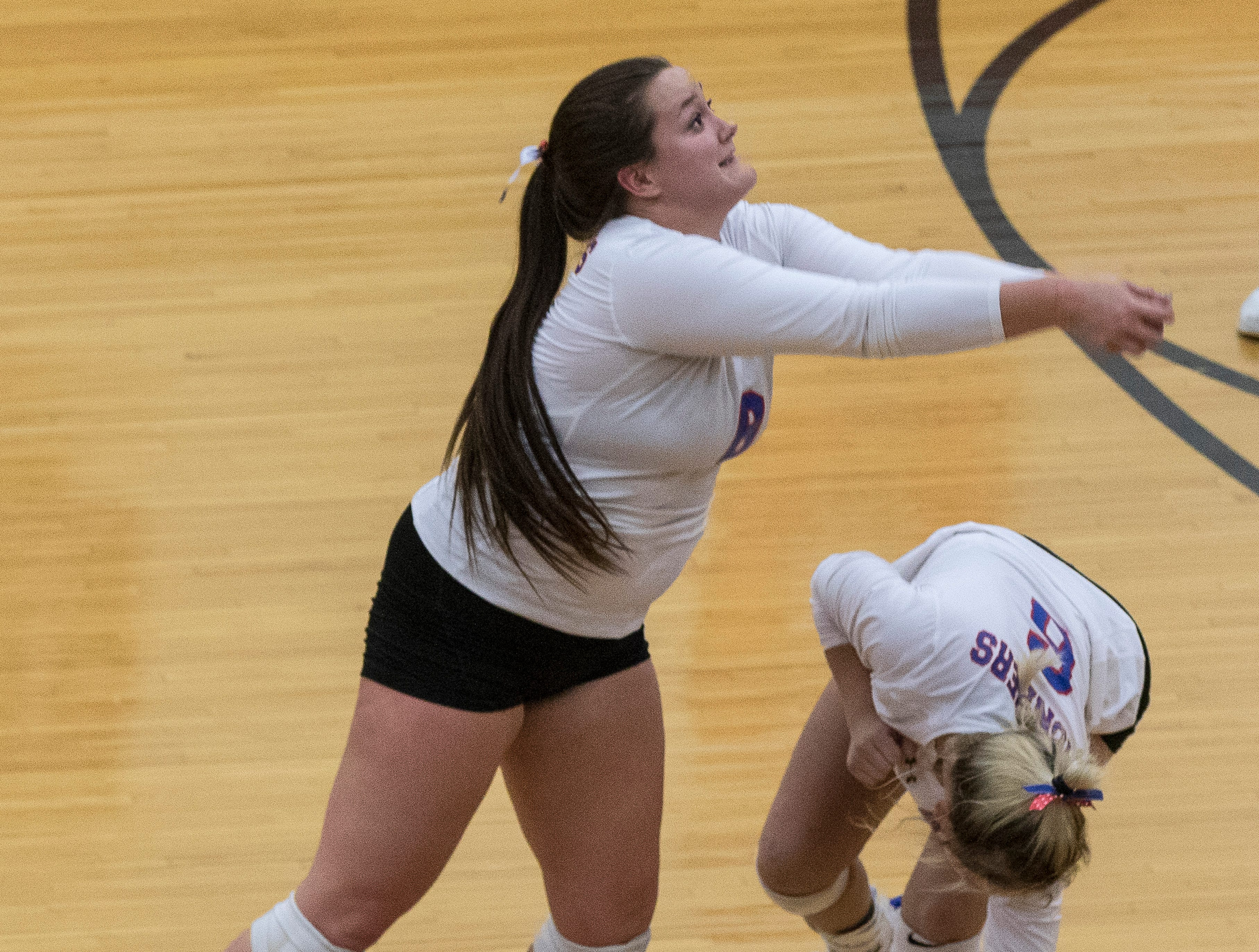 Zane Trace's Alli Bennett ducks as Hannah Unger quickly moves to return a volley sent by North Adams Wednesday night during a Division III district semifinals match. Zane Trace defeated North Adams 3-0, advancing them to district finals against Southeastern.