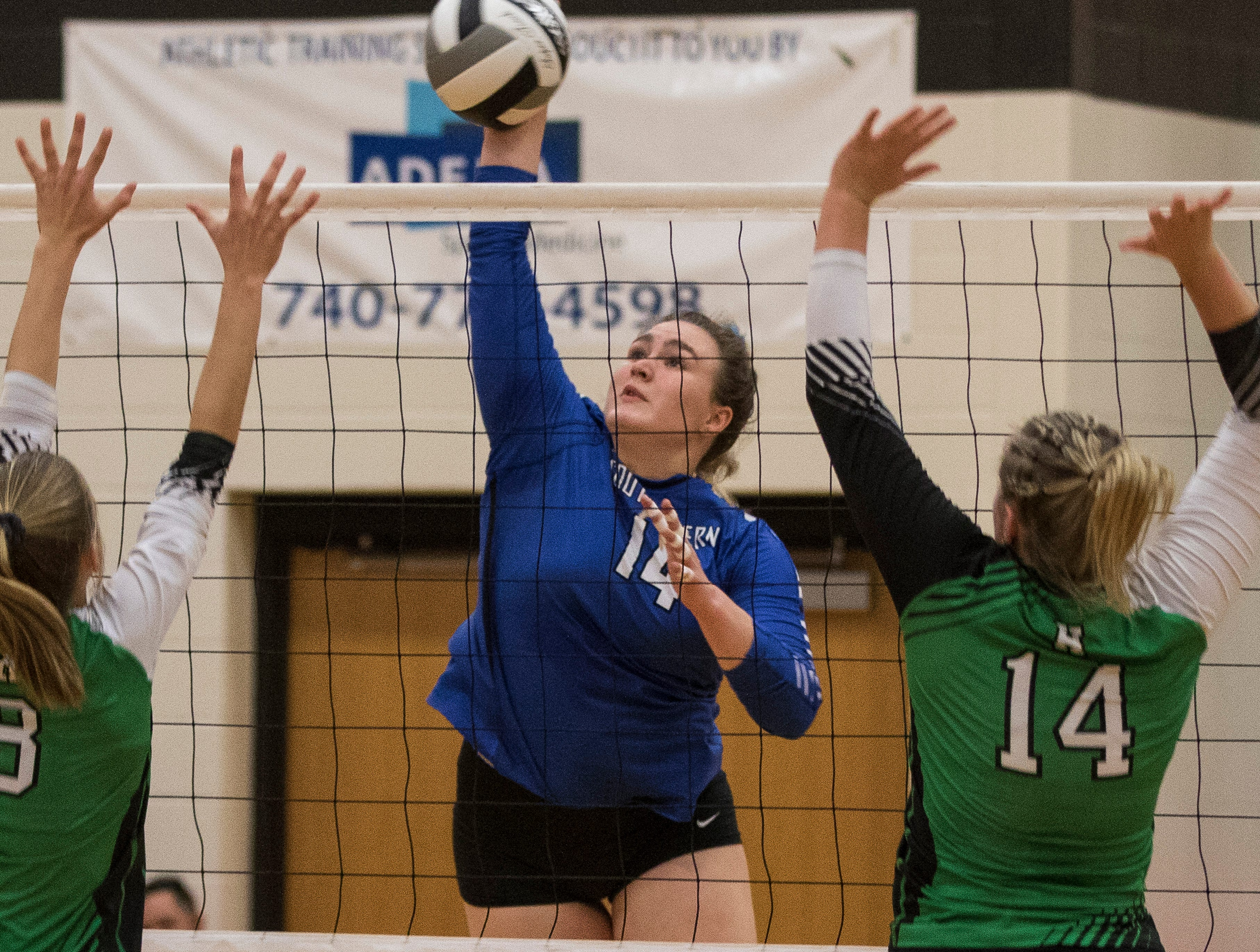 Southeastern' s Skylar Hice spikes the ball against Huntington Wednesday night during a Division III district semifinals match. Southeastern went on to defeat Huntington 3-2, advancing them to district finals against Zane Trace Saturday.
