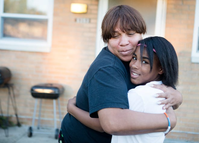 Donna Gowdey and her daughter, Donesha Gowdy, 12, stands outside her home on Monday, 22, 2018, in Cincinnati, Ohio. Donesha Gowdy was tasered in early August by a police officer at Kroger where she was allegedly shoplifting.