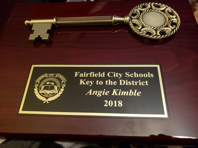 Fairfield bus drivers Angie Kimble and Lori Perpingon recently  received proclamations and the first-ever key to the district for their  efforts in helping a choking child.