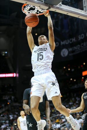 McDonald's All-American West forward Darius Bazley (15) dunks against the East in the second half of the McDonald's High School All American Game at Philips Arena.