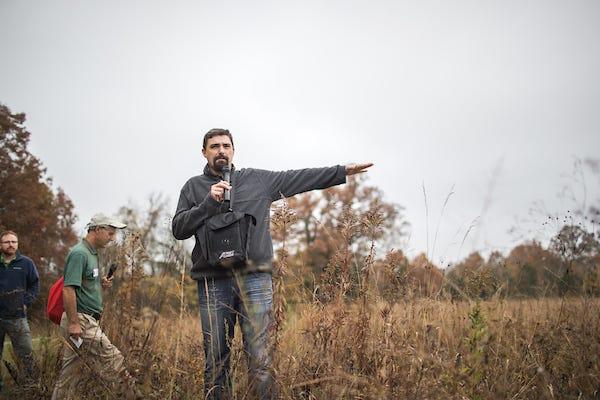 Associate Professor of Biology, Dr. Dwayne Estes, leads a tour through Baker Prairie Natural Area on Monday, Nov. 6, 2017.