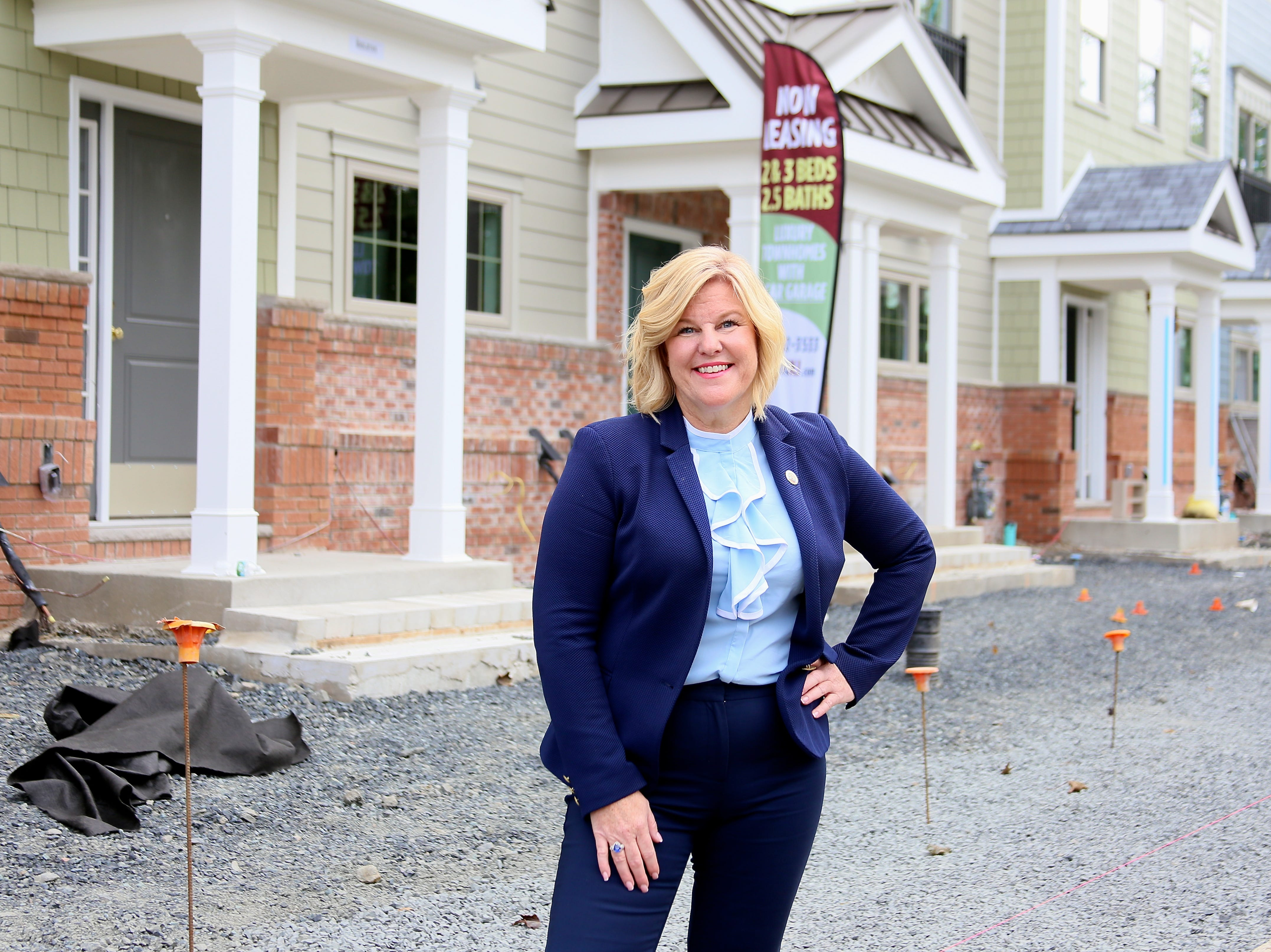 Fanwood Mayor Colleen Mahr is pictured outside Station Square at Fanwood, 35 townhouse-style rentals available now and to open in April. The project is one of two that complete the borough's downtown redevelopment plan.