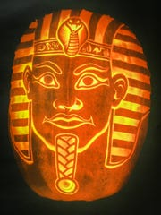 This elaborate pharaoh is a far cry from the basic design that is being jabbed and sawed out of pumpkins all across America each October.