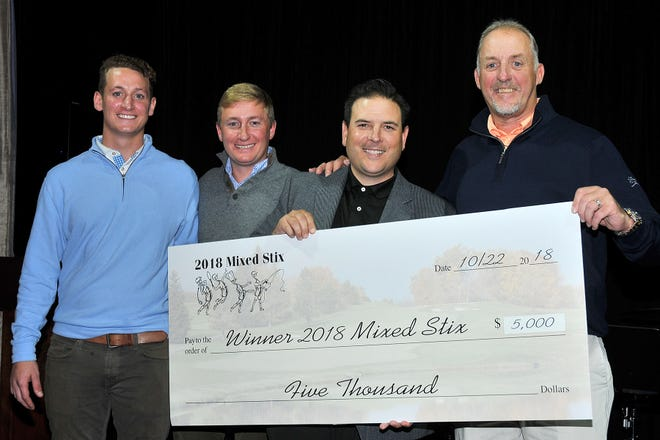 Tommy and Matt Donovan from the R&C Donovan Family Foundation, along with Kevin McCallen of Northeast Lock, present the winner's check to Mike Holiday of Upper Montclair Country Club.