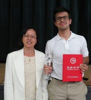 Stan DeLaurentiis of Plainfield, a senior at The Wardlaw + Hartridge School,with Wardlaw + Hartridge Upper School Mandarin instructor Hua Liu, represented his school and country well at the Chinese Bridge Chinese Proficiency Competition. The event, held in Kunming City of southwest China's Yunnan Province, featured 110 teams of two students from 99 countries and five continents. DeLaurentiis and his partner, Maxwell Horne of Riverdale Country Day School in New York, placed in the top 20 of this elite international competition.