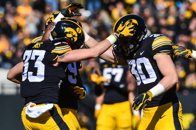 Jake Gervase (30) has been huge in providing stability on the defensive backend, while also bringing along newcomers like freshman cornerback Riley Moss (33). Gervase is a big reason why Iowa is 6-1.