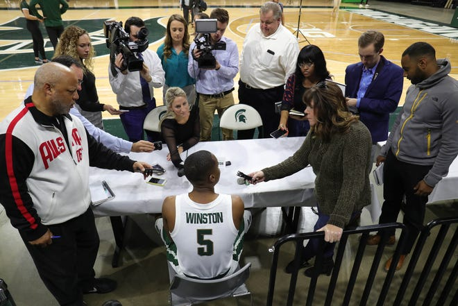 Michigan State guard Cassius Winston talks with reporters at media day Thursday, Oct. 25, 2018 at Breslin Center in East Lansing.