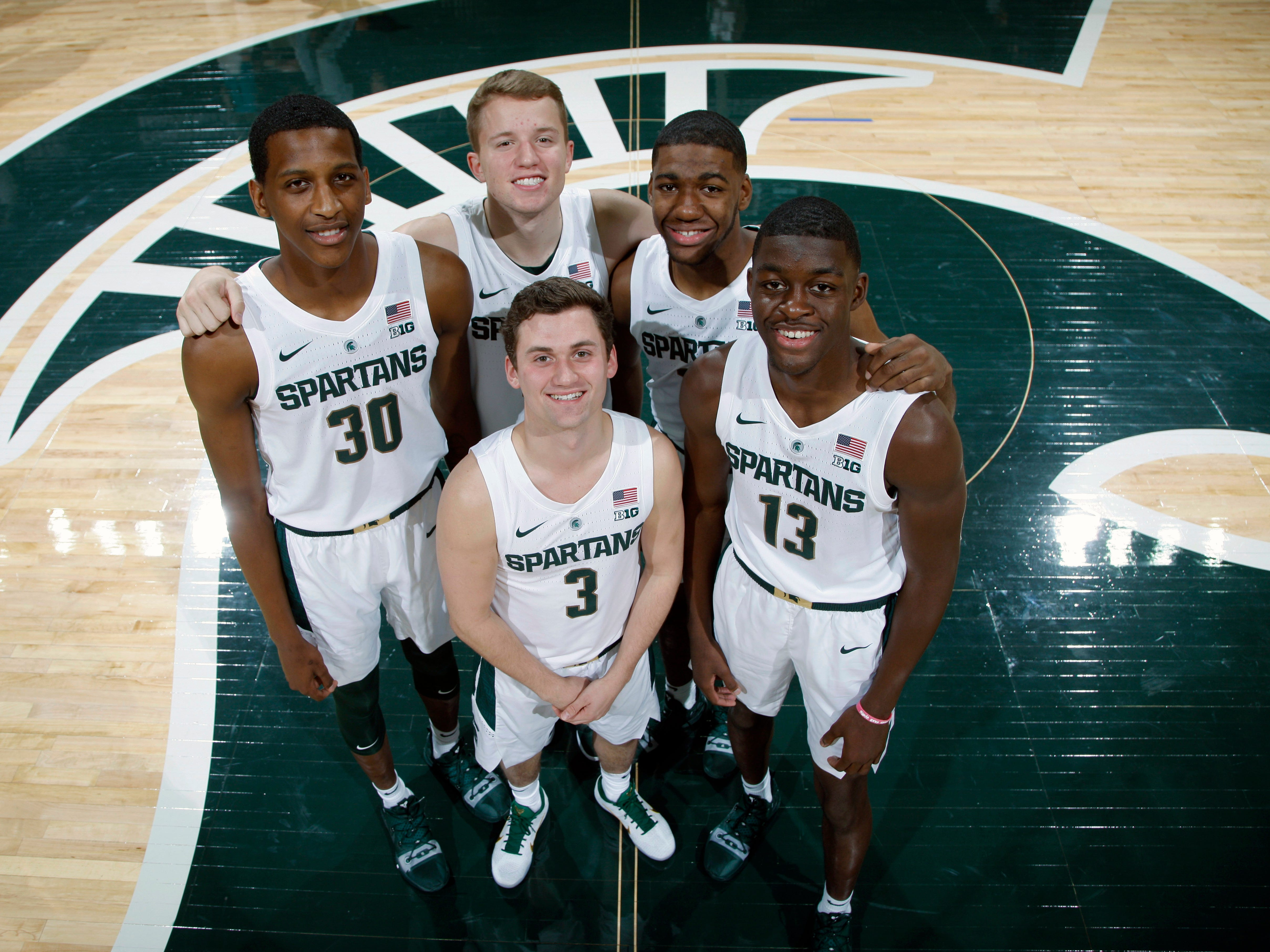 Michigan State freshmen Marcus Bingham Jr. (30), Thomas Kithier (15), Aaron Henry (11), Gabe Brown (13) and Foster Loyer (3) during media day, Thursday, Oct. 25, 2018, in East Lansing.