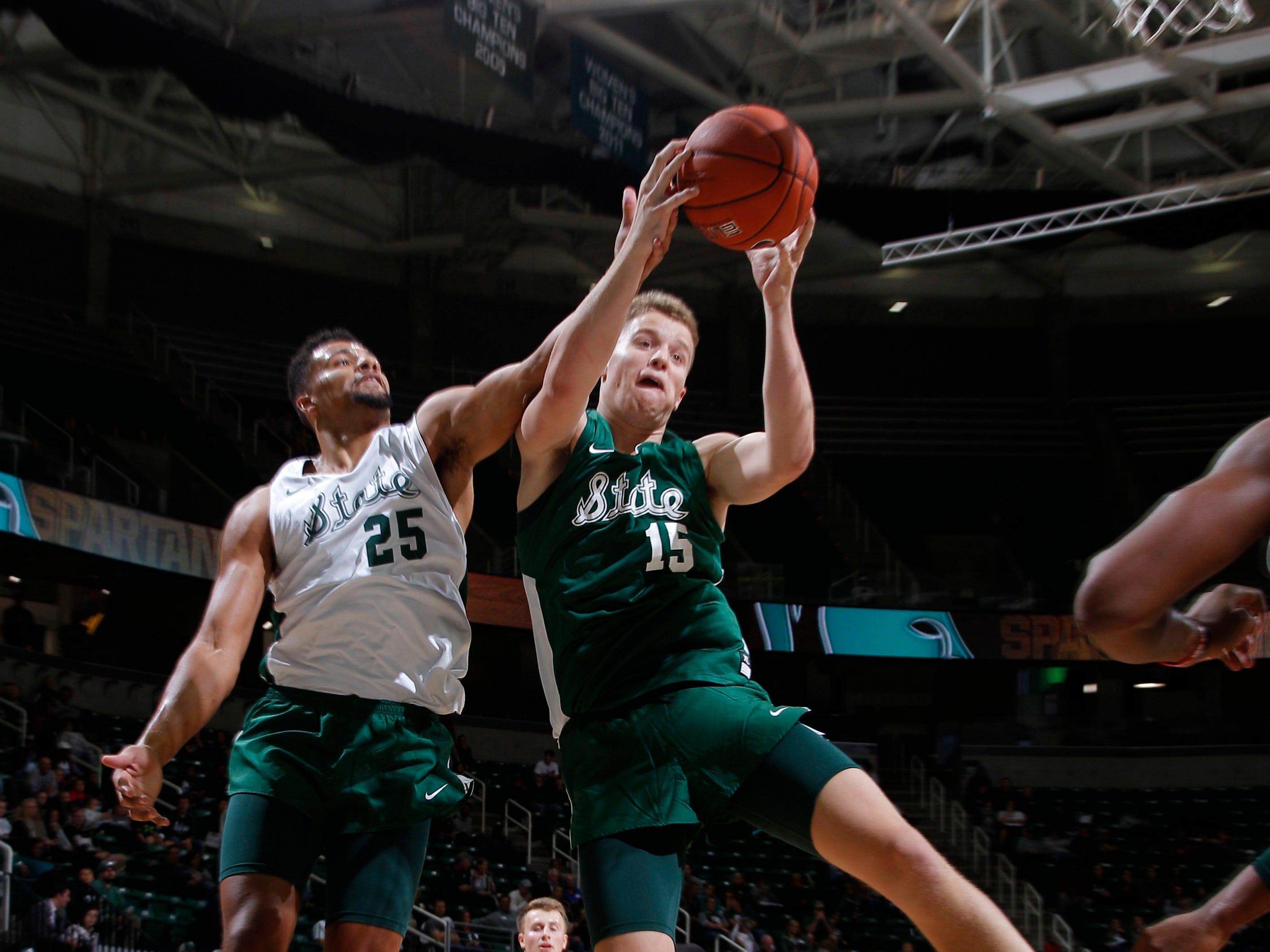 Michigan State's Thomas Kithier, right, and Kenny Goins fight for a rebound during a scrimmage Oct. 6, 2018, in East Lansing.