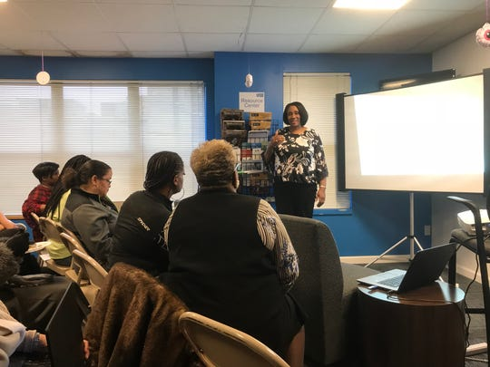 Stephanie Young, executive director of the Community Education Commission, talks to parents and others who attended a meeting at the Detroit Parent Network about a grading system for Detroit schools.
