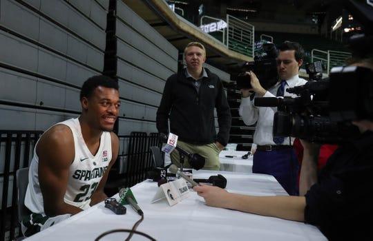 Xavier Tillman talks to reporters Thursday.