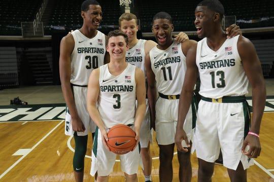 Michigan State freshmen Foster Loyer (3), Marcus Bingham Jr. (30), Thomas Kithier (15), Aaron Henry (11) and Gabe Brown (13) at media day Thursday.