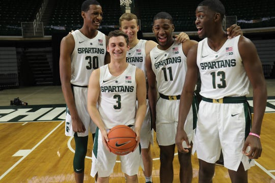 Michigan State freshmen Foster Loyer (3), Marcus Bingham Jr. (30), Thomas Kithier (15), Aaron Henry (11) and Gabe Brown (13) at media day Thursday.