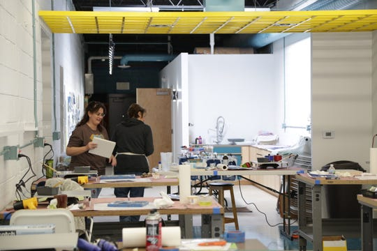 The renovated Color & Ink building more than triples its space from 1,800 square feet to 5,800 square feet, said Eric Law, a commercial photographer who co-owns the business with wife Candace Law, a mixed-media artist.
