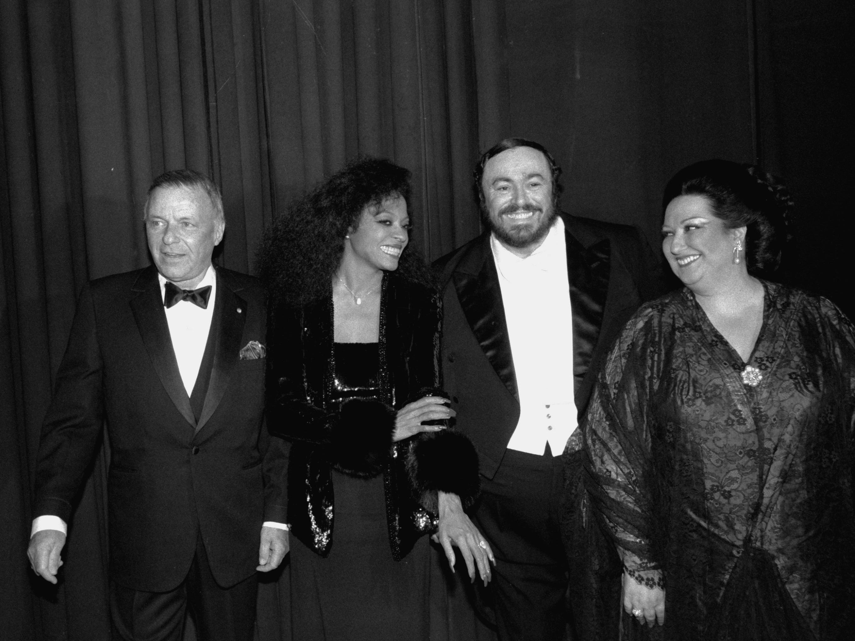 Frank Sinatra joins Diana Ross, Luciano Pavarotti and Montserrat Caballe on March 18, 1984, at New York's Radio City Music Hall before performing in a benefit concert for cancer research.  The sold-out performance raised $3.5 million for the Memorial Sloan-Kettering Cancer Center.