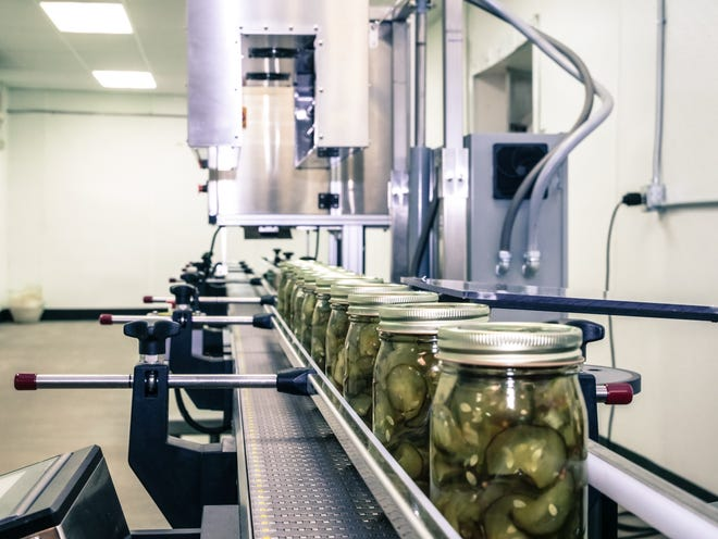 Pickles sit on a conveyor belt in a commercial kitchen for food entrepreneurs at Eastern Market Corp.'s Feast Detroit in Inkster. A similar concept for growing small businesses is coming to Detroit with the help of JPMorgan Chase.