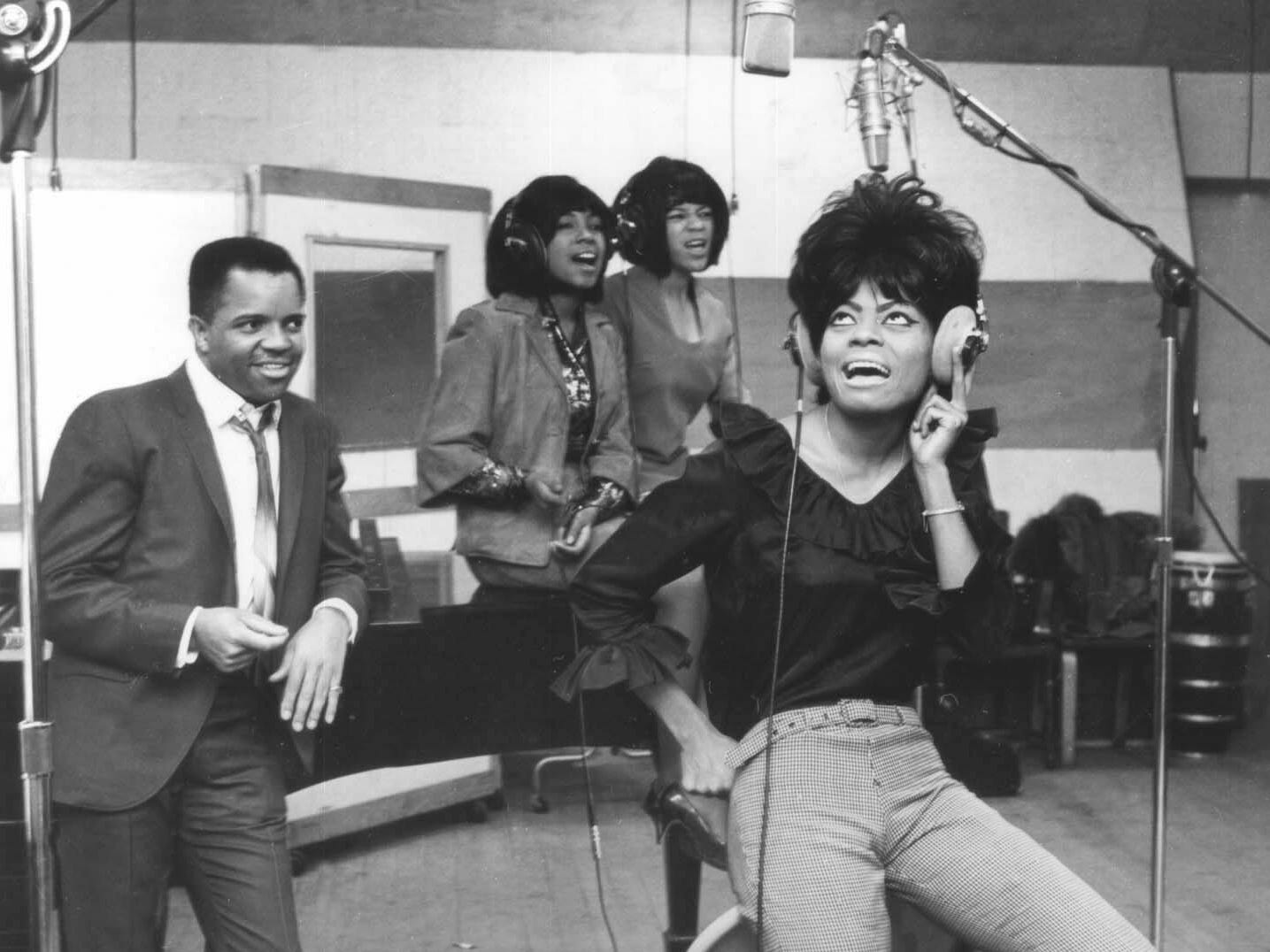 Berry Gordy Jr. listens to The Supremes — Mary Wilson, left, Florence Ballard and Diana Ross — lay down a track during a January 1965 recording session at Motown Records' Studio A, 2648 W. Grand Blvd. in Detroit. A copy of this photo is mounted on the wall of Studio A today for visitors to the Motown Museum.