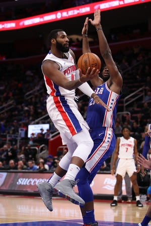 Andre Drummond goes to the basket against Joel Embiid on Tuesday night.