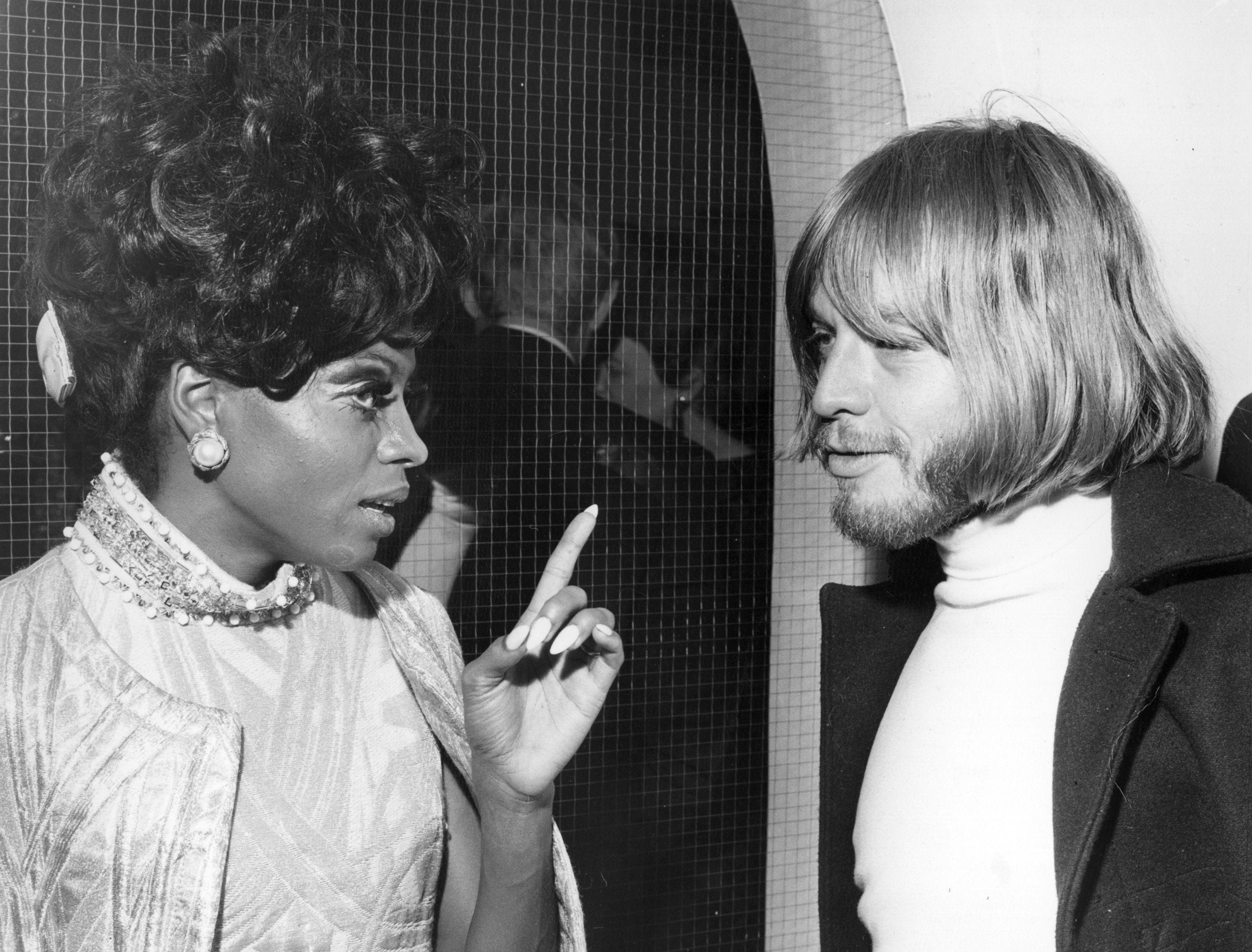 Diana Ross chats with Brian Jones of the Rolling Stones during an aftershow party hosted by the Duke and Duchess of Bedford to celebrate The Supremes performance on Sunday Night At the Palladium, Jan. 29, 1968.