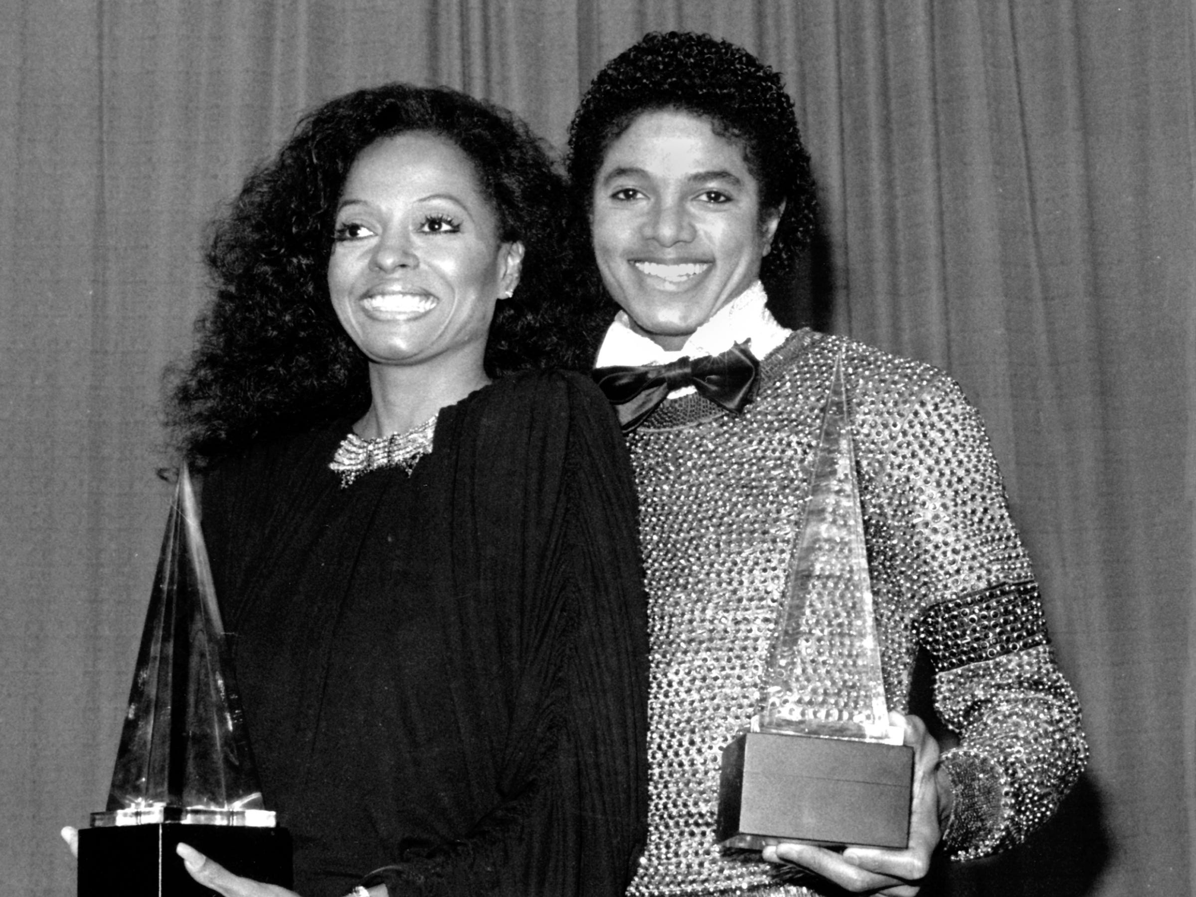 Music icons Diana Ross and Michael Jackson hold their American Music Awards in Los Angeles on Jan. 30, 1981.  Jackson won for favorite soul album and Ross for favorite female soul vocalist.  By this time Ross had left the Motown label and signed with RCA and Capitol Records.