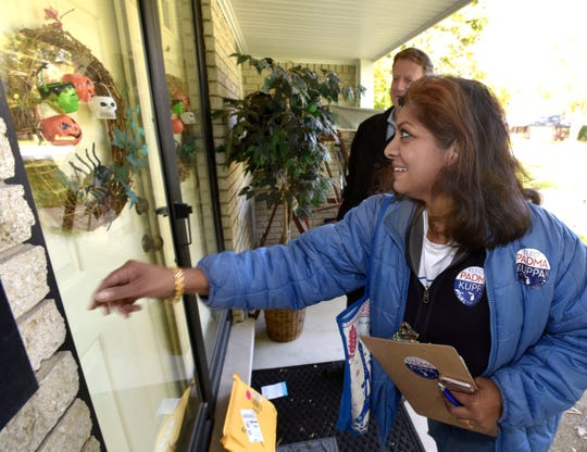 Padma Kuppa, a Democrat running for the 41st state House District that includes Troy and Clawson, knocks on a door while campaigning in Troy with Tim Greimel, minority leader of the state House.  Kuppa is currently a City of Troy Planning Commission member.